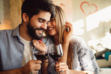 Couple clinking glasses with red wine. Couple celebrating anniversary, Valentine's day or International woman's day. - 191405243