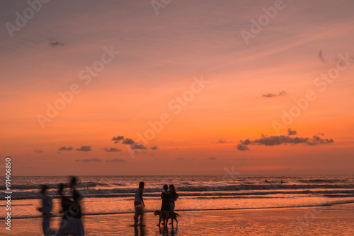 Foto op Aluminium Koraal Beach with people in sunset
