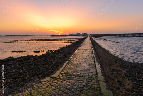 Fotobehang Zonsopgang View from Fort Louvois at low tide, Charente-Maritime, France