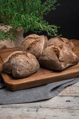 Homemade farm malt bread, malt flour on wooden table
