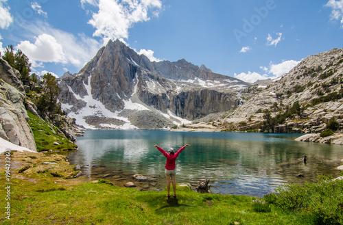 Girl Next to Beautiful Mountain Lake