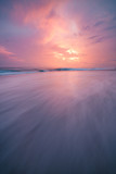 Sunset clouds and waves on empty beach Costa Rica - 191426042
