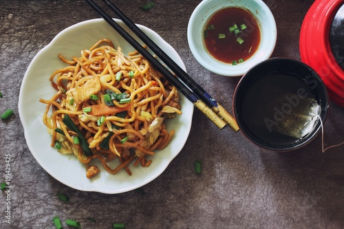Homemade Chiinese Lo Mein Noodles served with green tea overhead view - 191429425