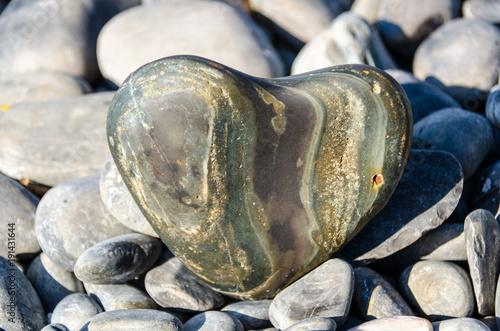 Aluminium Zen Stenen Heart-shaped sea stone on rock beach,Koh hin ngam , Lipe island, Thailand