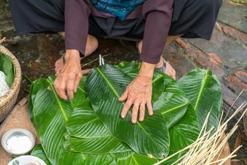 Woman hands preparing to make Chung Cake, the Vietnamese lunar new year Tet food