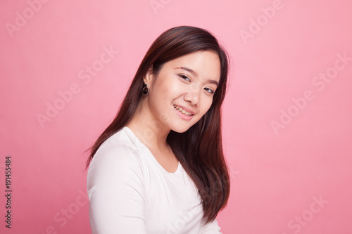 Plagát Beautiful young Asian woman on pink background
