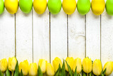 Easter background with tulips and eggs on wooden table - 191455871
