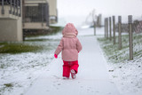 Adorable girl in winter jacket running on the snow - 191468485