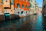 Traditional Venice gondola excursion, view of canal and  old architecture - 191469620