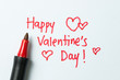 Happy Valentine's day written on white paper using red color pen - 191475800