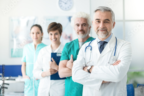 Zobacz obraz Confident doctors posing at the hospital