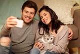 happy couple taking ...
