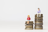 Gender pay equality concept. man and woman on a stack of coins. - 191509850
