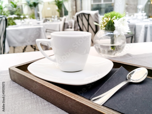 white cup of hot coffee on table
