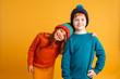 Quadro Two happy little children wearing warm hats.