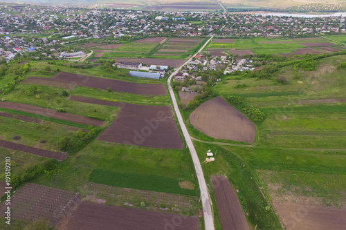 Foto Murales Dron View on Field and Village