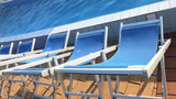 deckchairs lined up on the edge of a swimming pool - 191524244