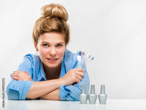 Staande foto Manicure Portrait of a beautiful young woman on a light background. Manicurist. Beauty salon employee
