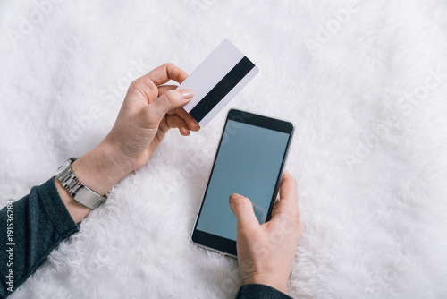 woman making online shopping on her phone