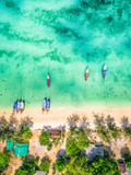 Aerial photography of boats moored in the water of an exotic beach. - 191549650