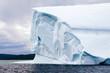 Iceberg Floating in Ocean Bay