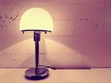 Lamp with round lampshade near concrete wall - 191572413