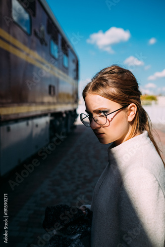 business trip. lady travel lifestyle. woman standing at a railway train station transport