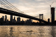 Stunning sunset over the Manhattan bridge and the Manhattan financial district across the East river from Brooklyn in New York City, USA