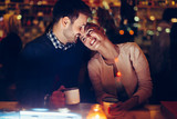 Romantic couple dating in pub at night - 191626841
