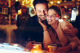 Romantic couple dating in pub at night - 191626872