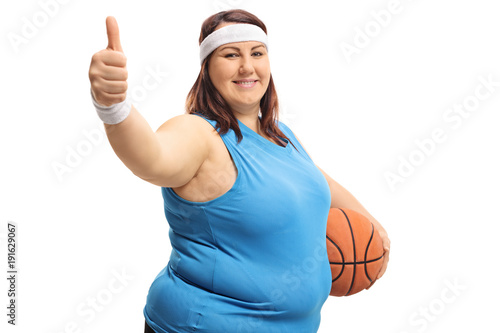 Aluminium Basketbal Overweight woman with a basketball making a thumb up gesture