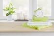 Leinwanddruck Bild - Spa towels on wooden table over blurred salon window background