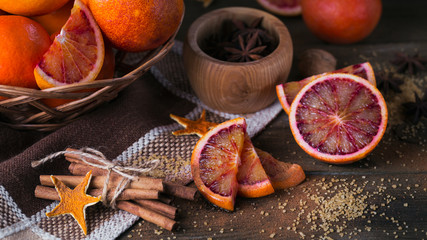 Fresh red orange fruit, anise, cinnamon and brown sugar