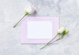 An arrangement of flowers and paper cards on gray background - 191638437