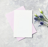 An arrangement of flowers and paper cards on gray background - 191638478