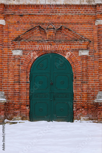 the door to the temple facade of the classic Church of the green door entrance