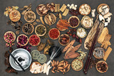 Chinese alternative medicine with herbs, acupuncture needles, moxa sticks used in moxibustion therapy and feng shui coins. Top view.  - 191654483