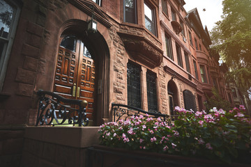 a view of a historic brownstone building in an iconic neighborhood of Manhattan, New York City