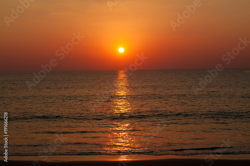 Foto op Canvas Baksteen Colorful Sunset on the beach