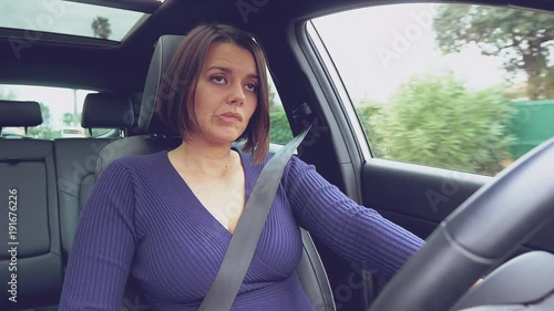 Funny angry woman driving car fighting with traffic