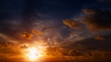 Dramatic, Firey Sunset with Puffy, Drifting Clouds - 191678043