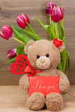 Postcard with a teddy bear and tulips.. Valentine's Day. Birthday. Mothers Day. Congratulatory background. - 191691429