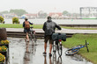 Couple seniors of cyclists in rainy day