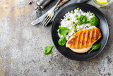 Chicken breast or fillet, poultry meat grilled and boiled white rice with green peas and fresh spinach leaves. Healthy diet menu for lunch - 191695003
