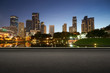 Asphalt road side with beautiful Kuala Lumpur city waterfront skyline. Night scene .