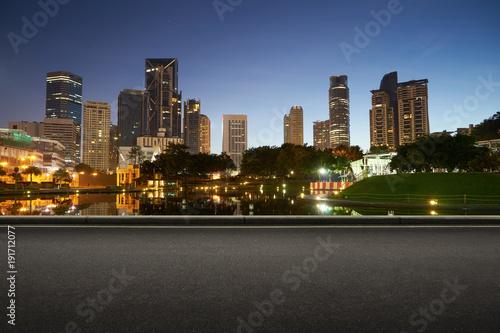 Fotobehang Kuala Lumpur Asphalt road side with beautiful Kuala Lumpur city waterfront skyline. Night scene .