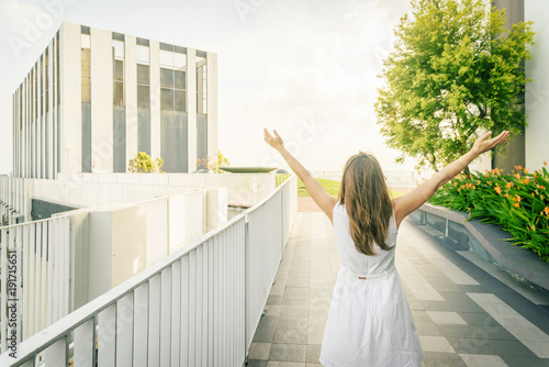 Young woman at rooftop garden of high-rise building