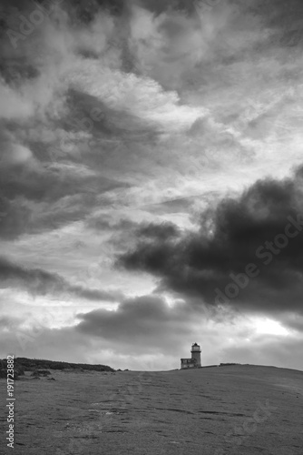 Aluminium Bleke violet Stunning black and white landscape image of Belle Tout lighthouse on South Downs National Park during stormy sky
