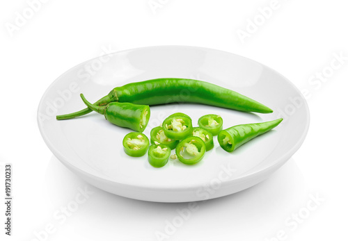 Fotobehang Hot chili peppers Green hot chili pepper in plate on white background