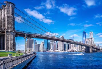brooklyn bridge in front of manhattan, new york